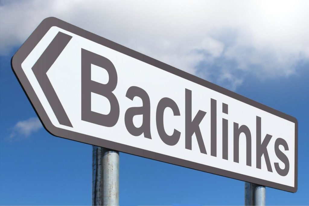 blue sky with white clouds and a black and white road sign that says 'backlinks' that are a part of SEO